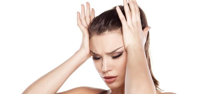 Young beautifull woman with headache